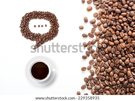 Coffee cup and speech bubble of coffee beans on white background. - stock photo