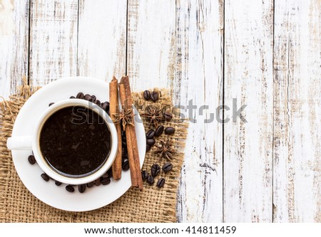 Coffee cup and spices on white wooden table vintage background. top view - stock photo