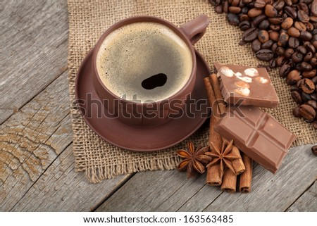 Coffee cup and spices on wooden table texture - stock photo