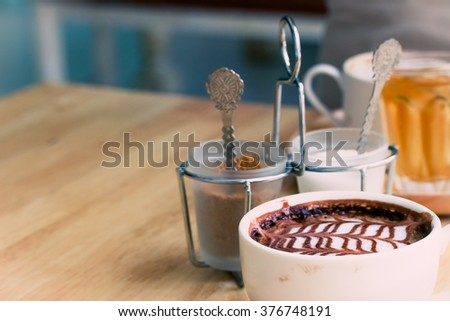 Coffee cup and sugar set in coffee shop. - stock photo