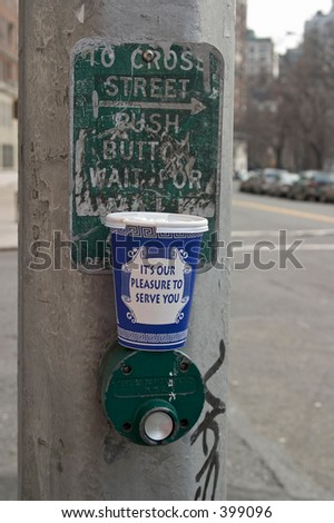 coffee cup at crosswalk - stock photo