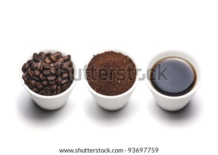 Coffee cup, beans and ground coffee - stock photo