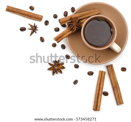 Coffee cup, cinnamon and anise stars as a corner of frame on white background