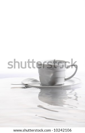 Coffee cup floating on waves