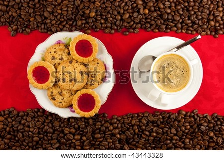 coffee cup from above with coffee beans - stock photo