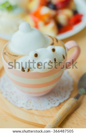 Coffee cup frothed milk teddy bear 3D art - stock photo