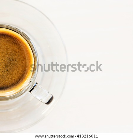 Coffee cup. Hot espresso with golden crema on white table in cafe. Top view - stock photo