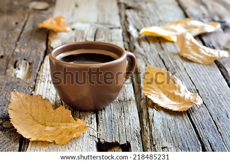 Coffee cup in an autumn morning - stock photo