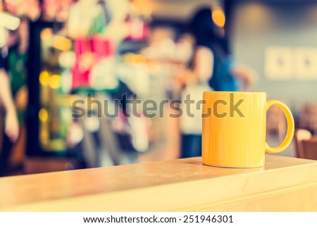 Coffee cup in coffee shop cafe - Vintage effect style pictures - stock photo