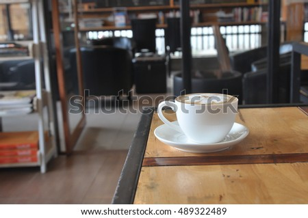 Coffee cup in coffee shop,Cup of coffee on a wooden table,cup of coffee on table in cafe,cup of cappuccino
