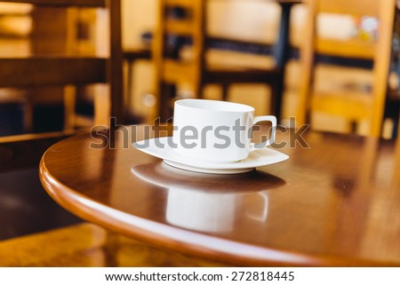 Coffee cup in coffee shop - vintage effect