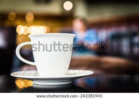 Coffee cup in coffee shop - vintage effect style pictures