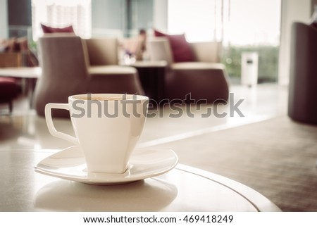 Coffee cup in coffee shop - Vintage Filter