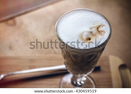 Coffee cup in coffee shop - vintage style effect picture on wooden background.cup of coffee on table in cafe ,Morning light cup of cappuccino, cup of coffee, cup of coffee on brown wooden table   - stock photo