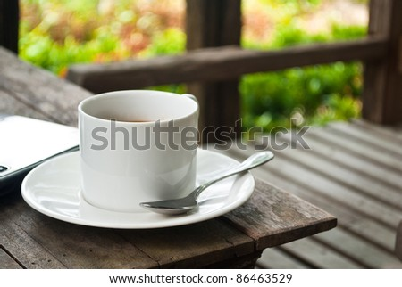 Coffee cup in the garden. - stock photo
