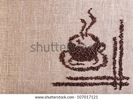 Coffee cup made of beans on burlap - with copy space