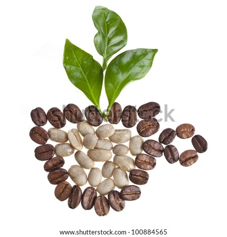 Coffee cup made of coffee beans and fresh leaves of coffee tree isolated on white - stock photo