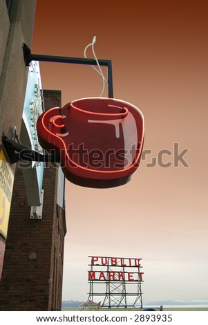 Coffee cup neon sign and Pike Street Market in Seattle - stock photo
