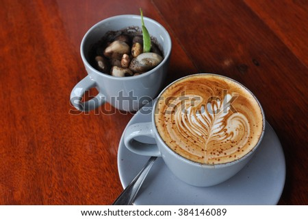 Coffee,cup of hot coffee on wooden table,hot milk art coffee on wooden table