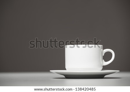 Coffee cup on a gray background. closeup - stock photo