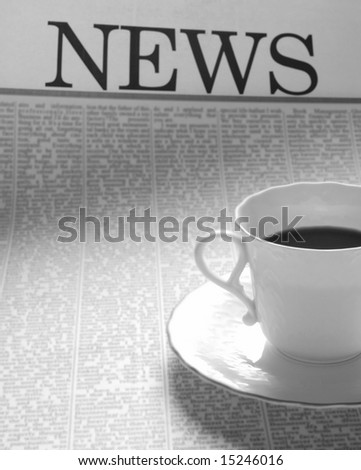 coffee cup on a newspaper page. news on breakfast. - stock photo