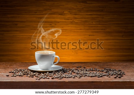 Coffee cup on a wooden table - stock photo