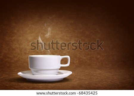 coffee cup on brown background - stock photo
