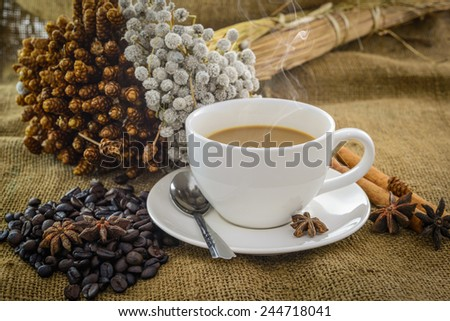 Coffee cup on jute sacks background - stock photo