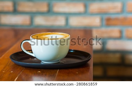 Coffee cup on  old table wooden.