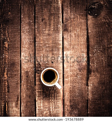 Coffee cup on old wooden background with copy space, top view. Coffee Espresso. Cup Of Coffee on dark brown wood table.   - stock photo