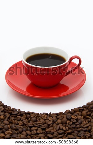 Coffee cup on the beans. Close up - stock photo