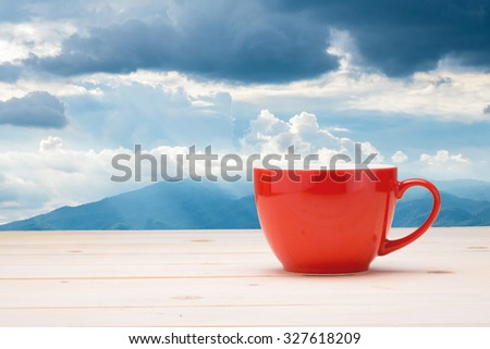 Coffee cup on the table in the morning. - stock photo