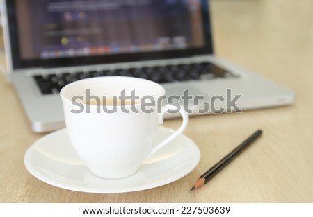 Coffee Cup on the Table with Computer  for Business Concept.