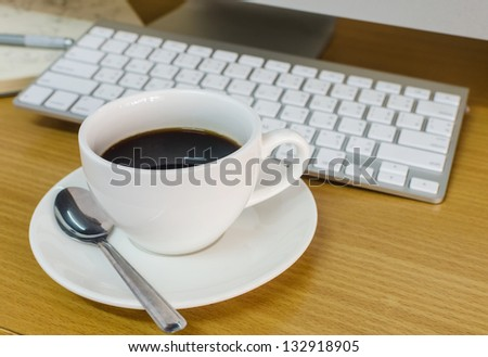 Coffee Cup on the Table with Computer Keyboard for Business Concept.