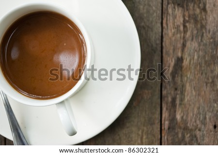 Coffee cup on the wood texture. - stock photo