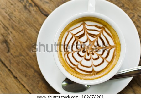 Coffee cup on the wood texture background, selective focus on coffee. - stock photo