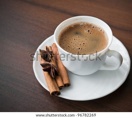 Coffee cup on the wooden table - stock photo