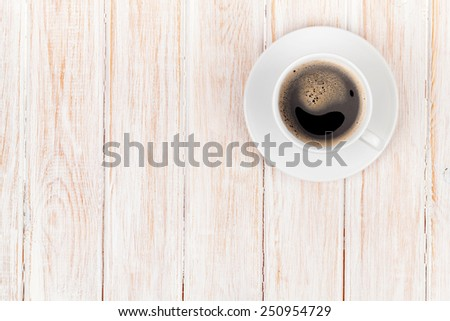 Coffee cup on white wooden table background. Top view with copy space  - stock photo