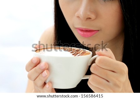 coffee cup on women hands
