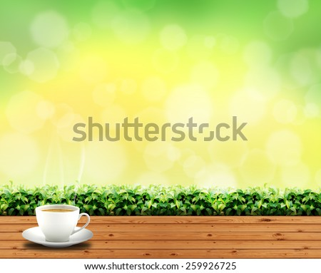 coffee cup on wood floor in outdoor park and sky green light background - stock photo