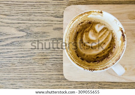 Coffee cup on wood surface with space - stock photo