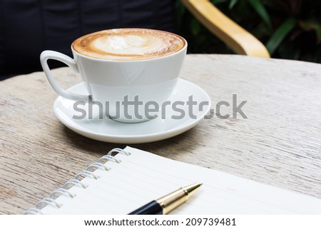 Coffee cup on wood table - stock photo
