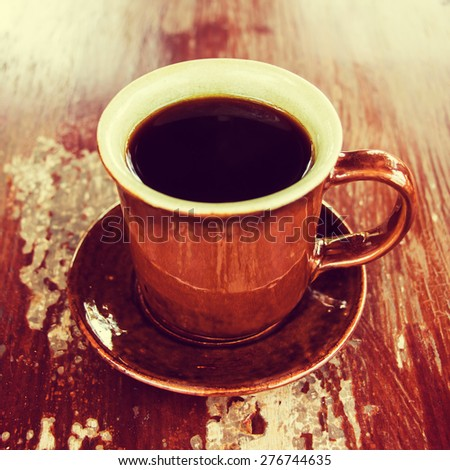 Coffee cup on wood table. (Process vintage tone) - stock photo