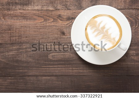 Coffee cup on wooden background. Top view. - stock photo