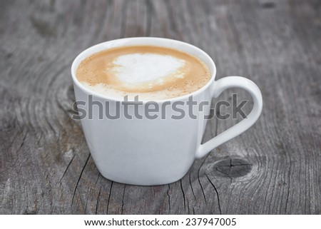Coffee cup on wooden table.