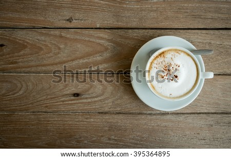 Coffee cup on wooden table background,Top view - stock photo