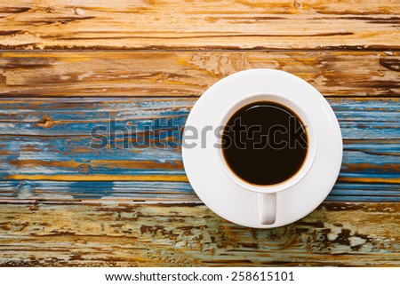 Coffee cup on wooden table - vintage effect pictures - stock photo