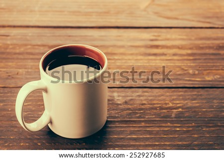 Coffee cup on wooden table - Vintage effect style pictures - stock photo