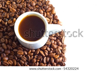 coffee cup over beans