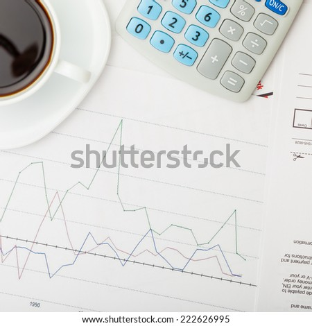 Coffee cup over some financial charts - view from top - 1 to 1 ratio - stock photo